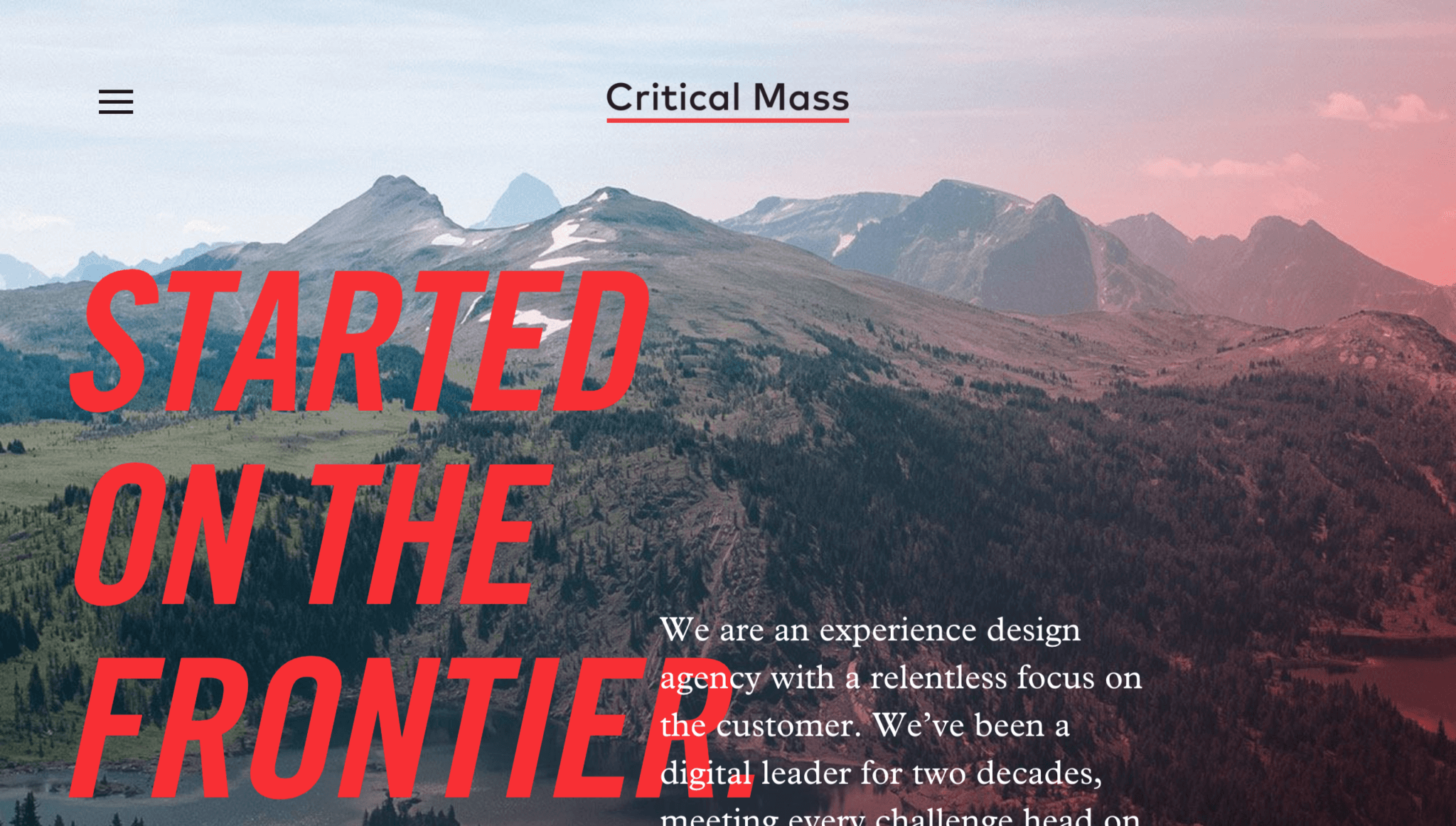 The Critical Mass page, with the text subtly positioned to encourage visitors to scroll down.